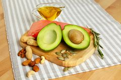 Gorduras saudáveis Alimento biológico fresco na tabela Fotografia de Stock Royalty Free