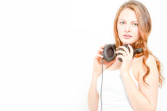 Gorgeous female holds headphones Stock Photo