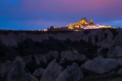 Goreme ancient city and a castle of Uchisar from a mountains. After twilight, Cappadocia in Central Anatolia, Turkey Stock Photos