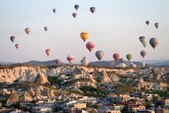 Goreme, Cappadocia, Turkey – April 25, 2018: hot air balloons flying over Goreme at sunrise stock photography