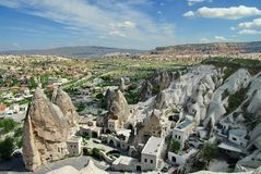 Hilly landscape - Goreme, Cappadocia - landmark attraction in Turkey. Hilly landscape. Cityscape in Goreme, Cappadocia - landmark attraction in Turkey royalty free stock photography