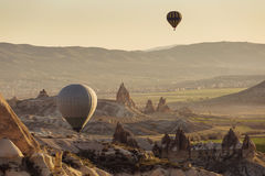 GOREME, TURKEY - APRIL 28: Hot air balloon fly over Cappadocia w Royalty Free Stock Image