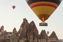 GOREME, TURKEY - APRIL 30: Hot air balloon fly over Cappadocia w Stock Images