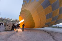 Goreme, Turkey / April 6, 2016 - Pilot fires the heater in his hot air balloon. As he prepares it for flight stock photos