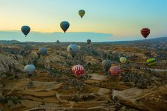 GOREME, TURKEY: Colorful Hot air balloons fly over Cappadocia, Goreme, Central Anatolia, Turkey. Hot-air ballooning is very. Popular tourist activity in royalty free stock photography