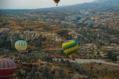 GOREME, TURKEY: Colorful Hot air balloons fly over Cappadocia, Goreme, Central Anatolia, Turkey. Hot-air ballooning is very. Popular tourist activity in royalty free stock photos