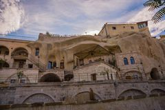 GOREME, TURKEY: Old rocks that serve as houses and hotels for tourists. Goreme is town in Cappadocia, Nevsehir Province, Central