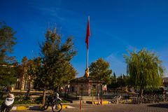 GOREME, TURKEY: Sculpture handshake holding the Turkish flag on the flagpole of the building in the center of Goreme. Goreme is town in Cappadocia, in the royalty free stock image