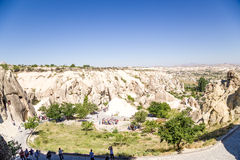 Goreme, Turkey. Tourists visiting the ruins of the medieval cave monastery complex Stock Photography