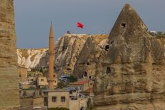 GOREME, TURKEY: View of the observation deck on the rock Turkish flag. Cappadocia, Nevsehir Province, Central Anatolia, Turkey