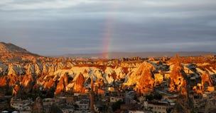 Goreme valley, Turkey, sun, clouds and rainbow Stock Photos