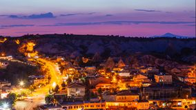 Goreme village with beautiful sky in Cappadocia at night in Turkey. Goreme village with beautiful sky in Cappadocia at evening time in Turkey Royalty Free Stock Images