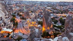 Goreme village in Cappadocia at sunset in Turkey. Goreme village in Cappadocia at evening time in Turkey Stock Photos