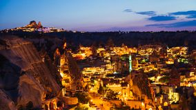 Goreme village in Cappadocia at night in Turkey. Goreme village in Cappadocia at sunset evening time in Turkey Stock Images