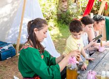 A participant in the knight festival shows visitors how to prepare aromatic drugs in Goren park in Israel. Goren, Israel, April 06, 2018 : A participant in the Royalty Free Stock Images