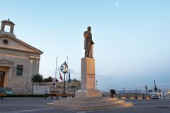 Gorg Borg Olivier statue with stock exchange building at Vallett. A, Malta Stock Images