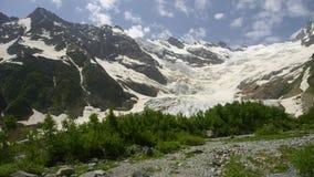 Gorge Alibek. Glacier  Alibek on Dombai. Caucasus Royalty Free Stock Image