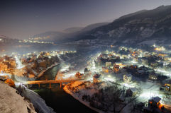Gorge of Iskar river near Tserovo, Bulgaria - night view. Beautiful winter picture with lights, stars, snowy landscape and romantic mood Royalty Free Stock Photos