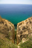Gorge in the mountains on the coast of the sea Royalty Free Stock Photography