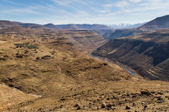 Gorge-ous Backyard View. A village in rural Leribe soaks in the sun on a dry winter afternoon above a valley in the mountain kingdom of Lesotho Stock Photo