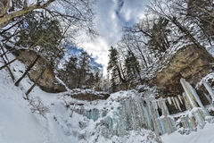 The Gorge of Tiffany. This is the fisheye view of the gorge at Tiffany Falls. If you look closely, you'll see an ice climber Stock Photography