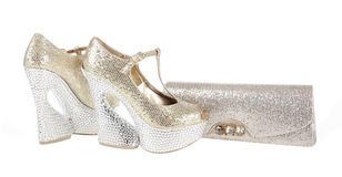 Gorgeos gold glitter shoes and clutch bag Royalty Free Stock Images