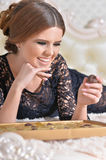Gorgeour woman eating candies Royalty Free Stock Image