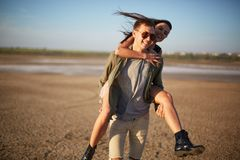 Young lovers having fun on a natural background. Cute romantic date. Relationship concept. Copy space. royalty free stock images
