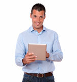 Gorgeous adult male using his tablet pc royalty free stock image