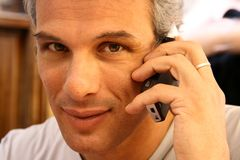 Gorgeous adult man at phone Stock Photos