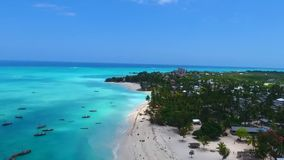 Gorgeous aerial drone view on small tourist boat luxury yacht ship vessel navigating in turquoise tropical island ocean. Gorgeous drone aerial view on small stock footage