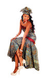 Gorgeous African American woman sitting. Royalty Free Stock Photos