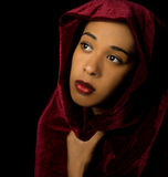 Gorgeous African American woman wearing a burgundy velvet shawl Royalty Free Stock Images
