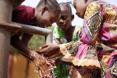 Free Gorgeous African Girls Washing Hands Under Water Tap Outdoors Stock Photos - 172697633