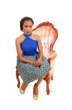 Gorgeous African woman in armchair. Royalty Free Stock Photo