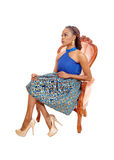 Gorgeous African woman in armchair. Royalty Free Stock Photography