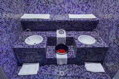 Gorgeous amazig, inviting view of a sauna spa relaxation room. Nice beautiful inviting view of a sauna spa dark blue ceramic tiles relaxation room Stock Photography