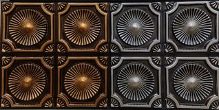 Beautiful detailed closeup view of dark bronze and silver color interior ceiling tiles, luxury background. Gorgeous amazing detailed closeup view of dark bronze royalty free stock image