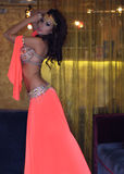 Gorgeous Arabian Woman Bellydancer, perfect sexy body and bright makeup. Indoors. Gorgeous Arabian Woman Bellydancer in orange costume indoors Royalty Free Stock Photography