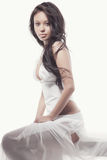 Gorgeous asian woman in white dress Royalty Free Stock Photography