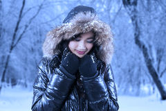 Gorgeous asian woman in winter park Royalty Free Stock Photos