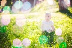 Gorgeous baby girl on a sunny meadow portrait Stock Photos