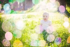 Gorgeous baby girl on a sunny meadow portrait Stock Photo