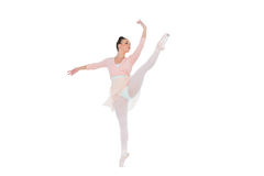 Gorgeous ballerina dancing rising her leg Stock Images