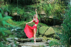 Gorgeous ballerina performing outdoors in the nature Stock Image