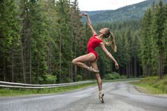 Ballerina posing outdoors stock photography