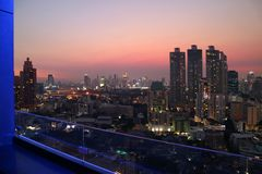 Gorgeous Bangkok urban against the evening sky view from rooftop terrace. Thailand aerial afterglow architecture asia beautiful blue building capital city stock photo