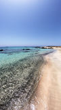 Gorgeous beach with turquoise crystal clear waters. Amazing beach of Elafonisi Crete Greece with the turquoise crystal clear water and pink white and black sand Royalty Free Stock Photography