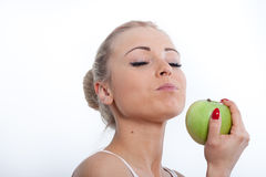 Gorgeous beautiful blonde girl and green apple Royalty Free Stock Photos