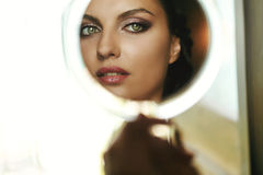 Gorgeous beautiful exotic bride with green eyes mirror reflectio Royalty Free Stock Image
